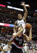Portland Trail Blazers center Robin Lopez (42) goes up for a shot as Memphis Grizzlies guard Tony Allen (9) closes in during the first half of an NBA basketball game on Tuesday, March 11, 2014, in Memphis, Tenn. (AP Photo/Mark Humphrey)