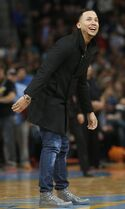 Colorado Rockies outfielder Carlos Gonzalez follows the flight of his half-court shot during a timeout as the Boston Celtics faced the Denver Nuggets in the fourth quarter of an NBA basketball game Friday, Jan. 23, 2015, in Denver. The Celtics won 100-99. (AP Photo/David Zalubowski)