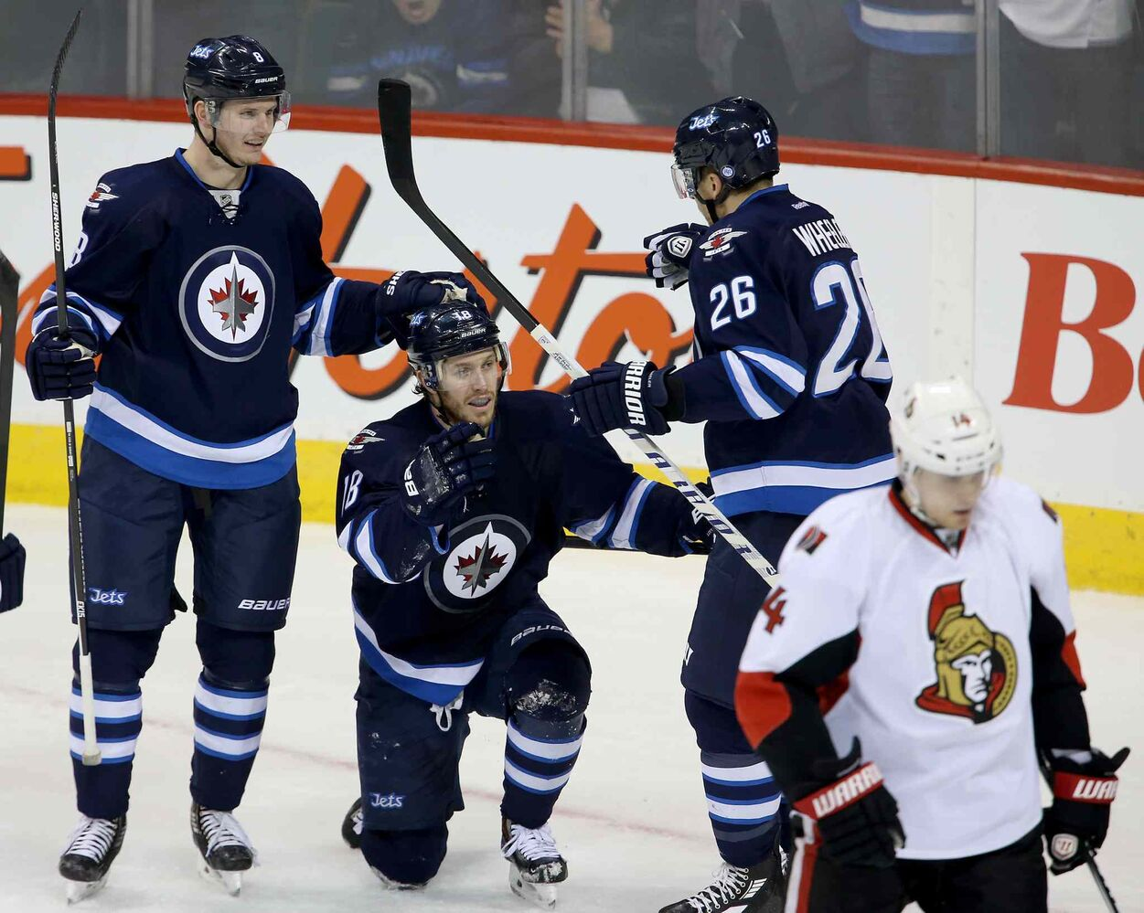 Winnipeg Jets' Jacob Trouba (8), Bryan Little (18) and Blake Wheeler (26) celebrate as Ottawa Senators' Colin Greening (14) looks on after Little scored during first period NHL hockey action at MTS Centre in Winnipeg Saturday.  (TREVOR HAGAN / WINNIPEG FREE PRES)