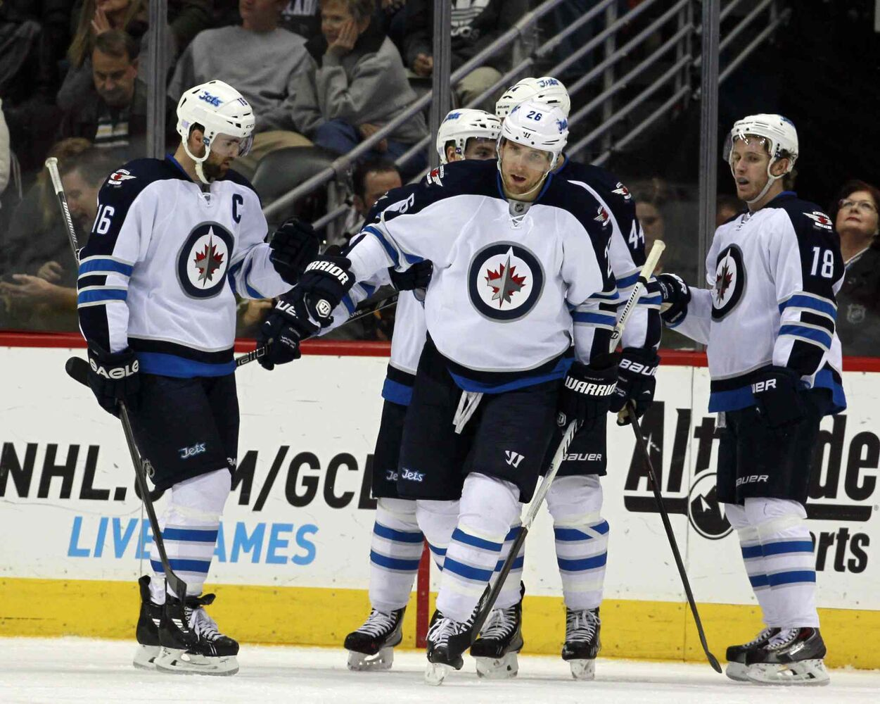 Blake Wheeler (centre) celebrates his power play goal with Andrew Ladd (left) and centre Bryan Little (right) in eth second period. (David Zalubowski / The Associated Press)