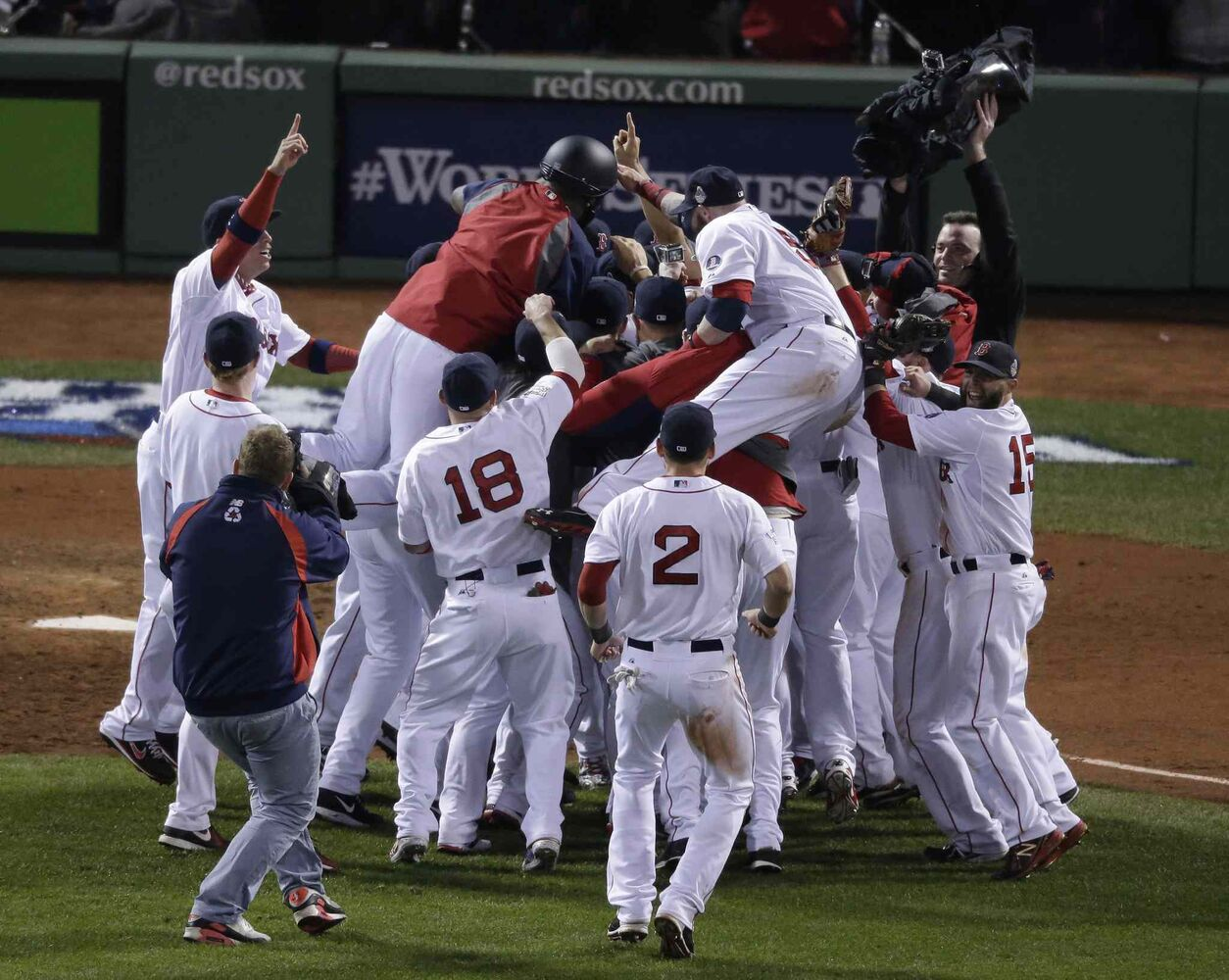 The Boston Red Sox celebrate after defeating the St. Louis Cardinals. (Charlie Riedel / The Associated Press)