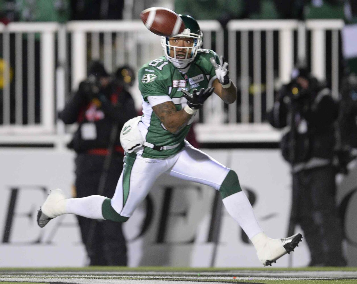 Saskatchewan Roughriders slotback Geroy Simon catches the ball in the end zone for a touchdown as they face the Hamilton Tiger-Cats during first quarter of the Grey Cup Sunday November 24, 2013 in Regina. THE CANADIAN PRESS/Frank Gunn (Frank Gunn / The Canadian Press)