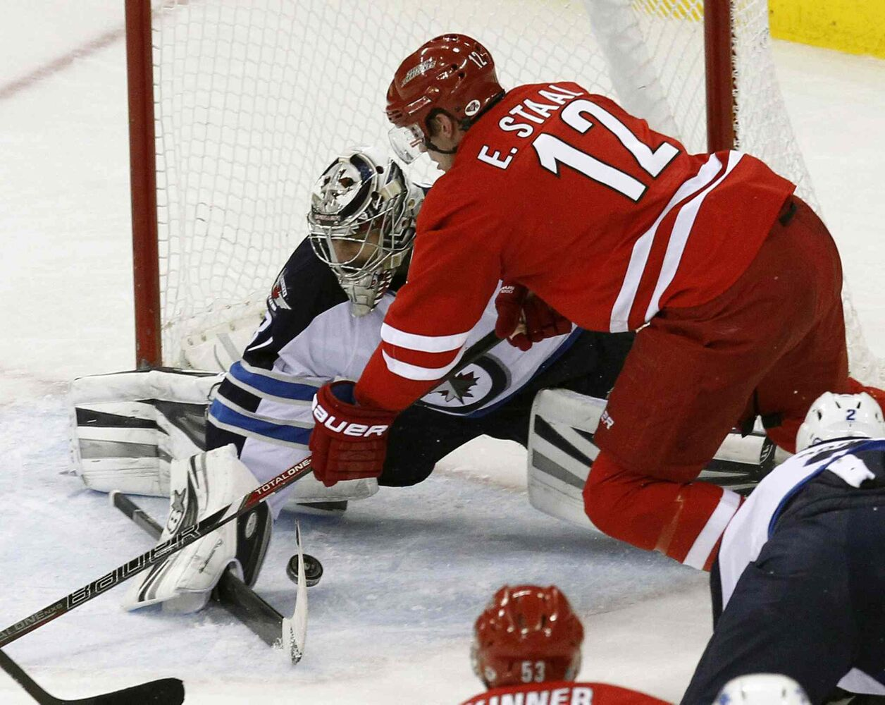 Carolina Hurricanes' Eric Staal (12) can't score against Winnipeg Jets' Ondrej Pavelec (31) during the second period at the PNC Arena in Raleigh, N.C., on Tuesday. (Chris Seward / Raleigh News & Observer/ Tribune Media MCT)