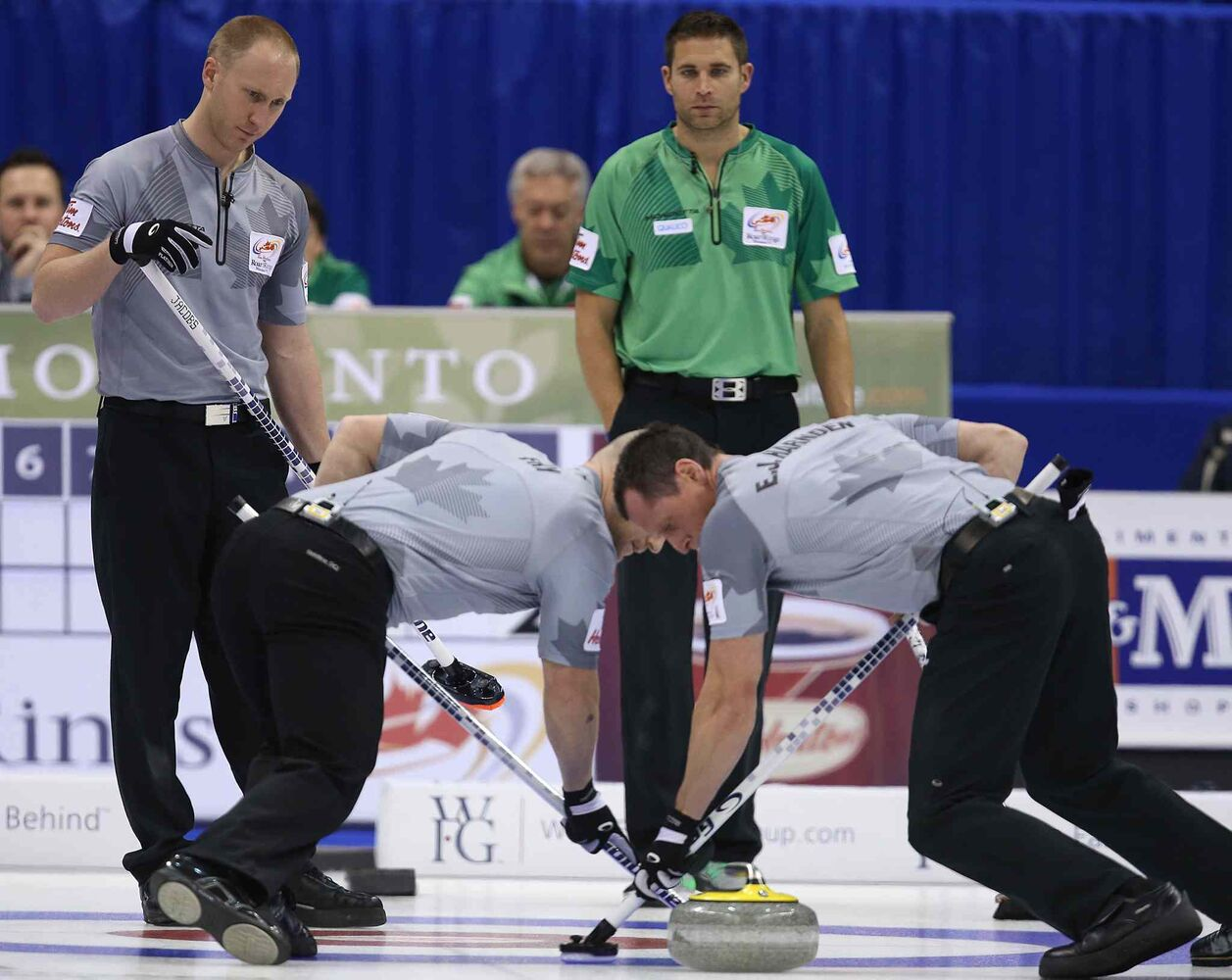 Skip Brad Jacobs (left) watches a shot during action against John Morris (centre).
