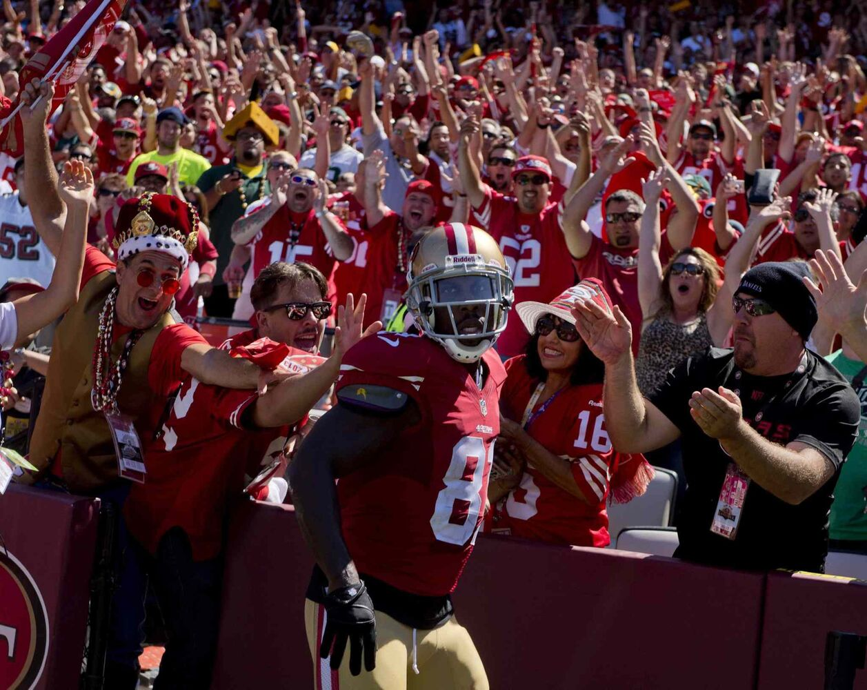 San Francisco 49ers wide receiver Anquan Boldin celebrates with fans after a ten-yard touchdown catch in the second quarter against the Green Bay Packers in September 2013. (Jose Luis Villegas / Sacramento Bee / MCT files)