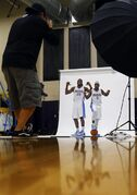Denver Nuggets' Kenneth Faried (35) and Ty Lawson pose for team photographer Garrett Ellwood during NBA basketball media day Monday, Sept. 29, 2014, in Denver. (AP Photo/Jack Dempsey)