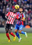 Southampton's Saido Mane, left, and Crystal Palace's Adrian Mariappa vie for the ball during their English Premier League soccer match at Selhurst Park, London, Friday, Dec. 26, 2014. (AP Photo/Tim Parker, PA Wire) UNITED KINGDOM OUT - NO SALES - NO ARCHIVES