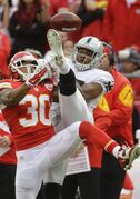 Kansas City Chiefs defensive back Jamell Fleming (30) breaks up a pass intended for Oakland Raiders wide receiver Brice Butler (12) during the second half of an NFL football game in Kansas City, Mo., Sunday, Dec. 14, 2014. (AP Photo/Charlie Riedel)
