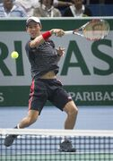 Kei Nishikori of Japan return the ball against France's Jo-Wilfried Tsonga during their third round match at the ATP World Tour Masters tennis tournament at Bercy stadium in Paris, France, Thursday, Oct. 30, 2014. (AP Photo/Jacques Brinon)