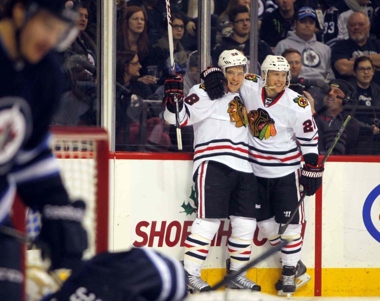 Chicago Blackhawks forwards Ben Smith (left) and Kris Versteeg celebrate after Smith's third-period goal.