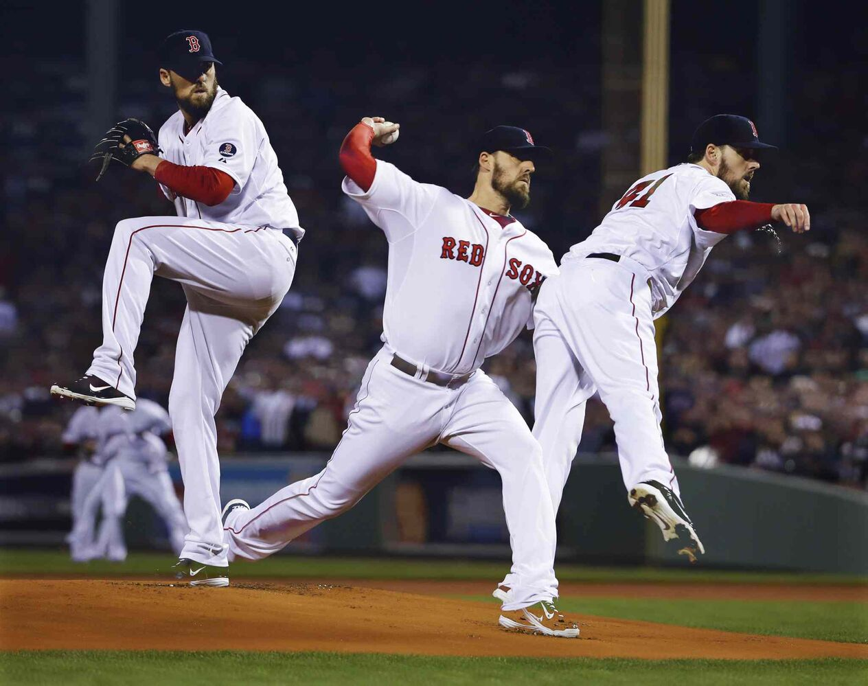 In a multiple exposure, Boston Red Sox starting pitcher John Lackey throws during the first inning. (Matt Slocum / The Associated Press)