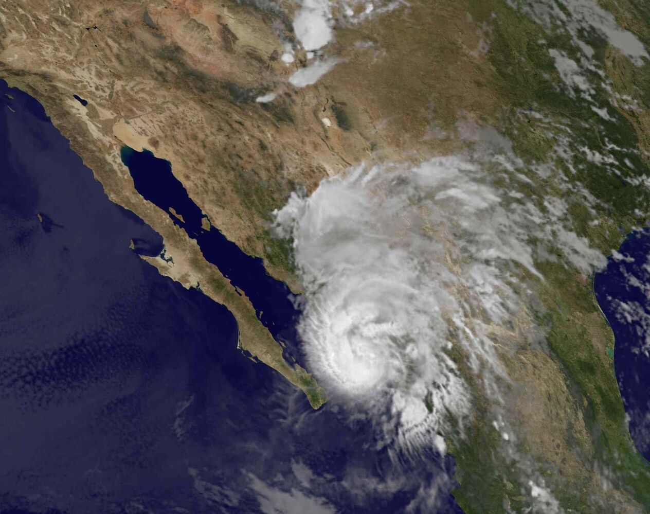 This image provided by NOAA shows Hurricane Manuel taken at 3:45 a.m. EDT Thursday Sept. 19, 2013. The U.S. National Hurricane Center said Manuel was a Category 1 hurricane hugging Mexico's coast early Thursday and expected to produce 75 mph winds and between 5 and 10 inches of rain over the state of Sinaloa. (NOAA / The Associated Press)