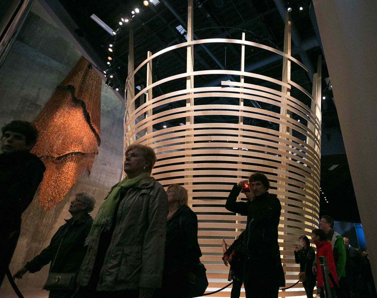 Visitors walk past the inverted woven basket in the Indigenous Perspectives gallery at the Canadian Museum for Human Rights on Saturday. Thousands had reserved tickets for the four gallery preview tour on Saturday and Sunday. That is only four of 11 galleries, the rest of which open Sept. 27. (Melissa Tait / Winnipeg Free Press)