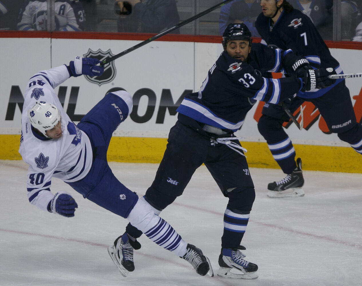 Jets' forward Dustin Byfuglien knocks down Leafs' forward Troy Bodie in the second period at MTS Centre Saturday night.  (Melissa Tait / Winnipeg Free Press)