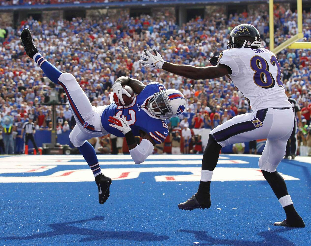 Buffalo Bills safety Aaron Williams (left) intercepts a pass intended for Baltimore Ravens wide receiver Torrey Smith during the Bills 23-20 victory Sunday in Orchard Park, N.Y. (Bill Wippert / The Associated Press)