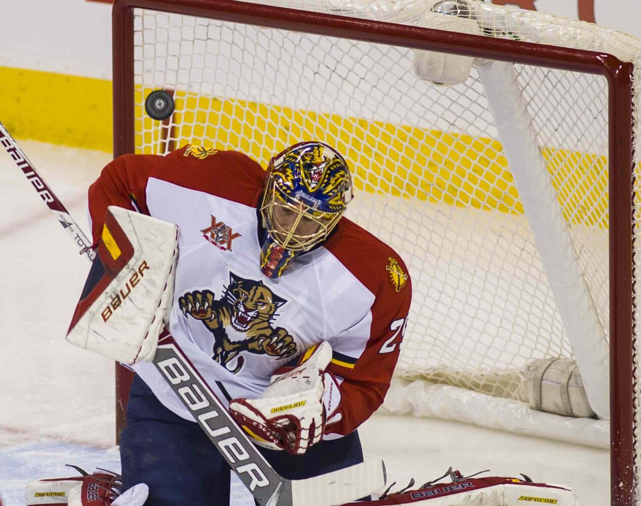 Florida Panthers goal tender Jacob Markstrom (#25) defects the puck during the first period action.