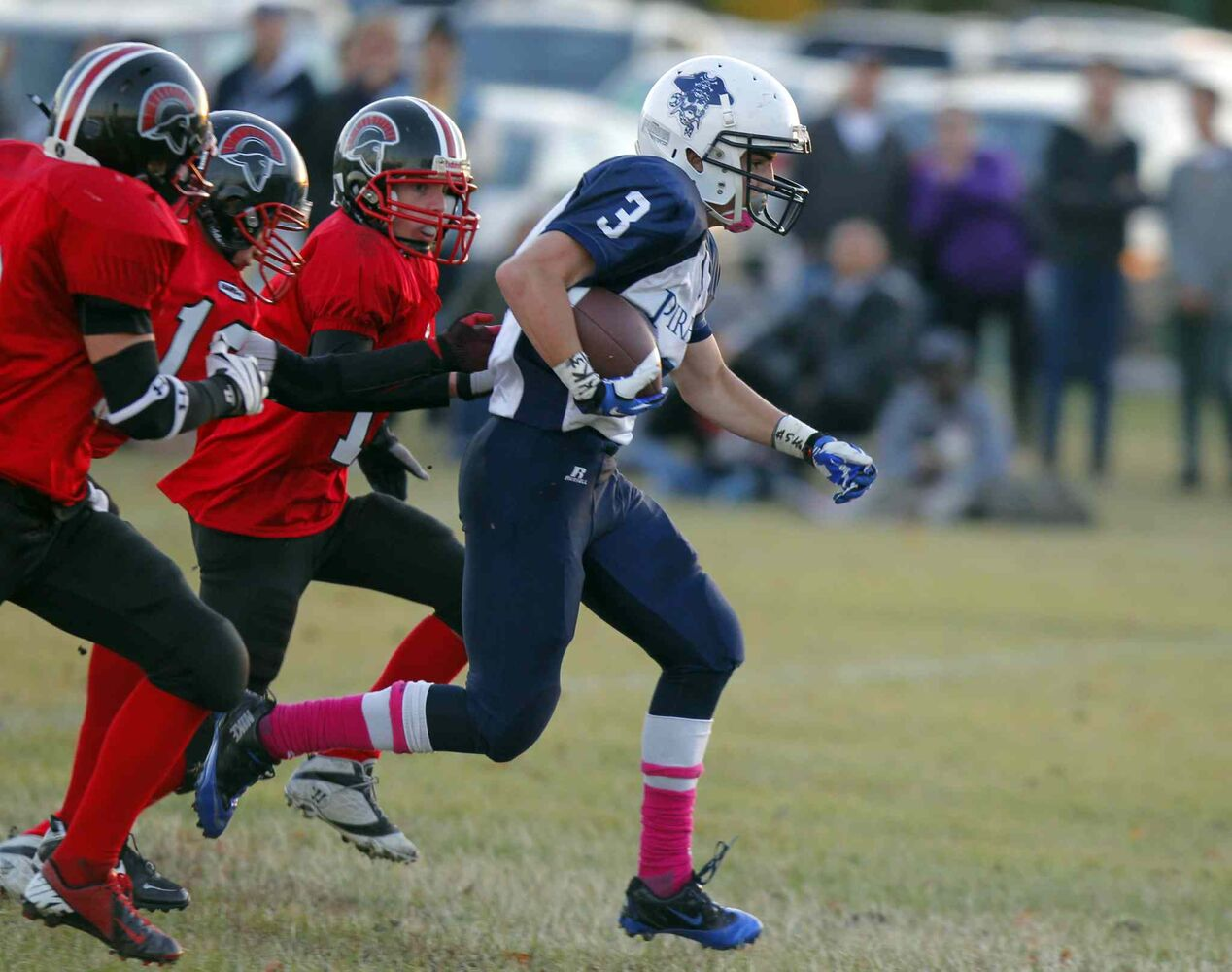 Pirates running back Josh Weichel (3) is pursued by members of the Sisler Spartans.