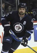 Jets D-man Mark Stuart shows strong character on and off the ice, says he believes in the team and wants to keep playing here.