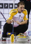 Manitoba skip Reid Carruthers examines a shot during curling action against Ontario at the Brier in Calgary, Thursday.