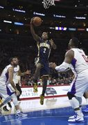 Indiana Pacers guard Rodney Stuckey, center, goes up for a shot as Los Angeles Clippers guard Jordan Farmar, left, and forward Glen Davis defend during the first half of an NBA basketball game, Wednesday, Dec. 17, 2014, in Los Angeles. (AP Photo/Mark J. Terrill)