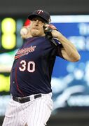 Minnesota Twins starting pitcher Kevin Correia delivers to the Chicago White Sox during the third inning of a baseball game in Minneapolis, Friday, July 25, 2014. (AP Photo/Ann Heisenfelt)