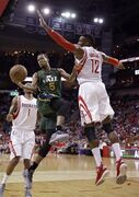 Utah Jazz's Rodney Hood (5) goes up against Houston Rockets' Dwight Howard (12) during the second half of an NBA basketball game Wednesday, April 15, 2015, in Houston. The Rockets won 117-91. (AP Photo/David J. Phillip)