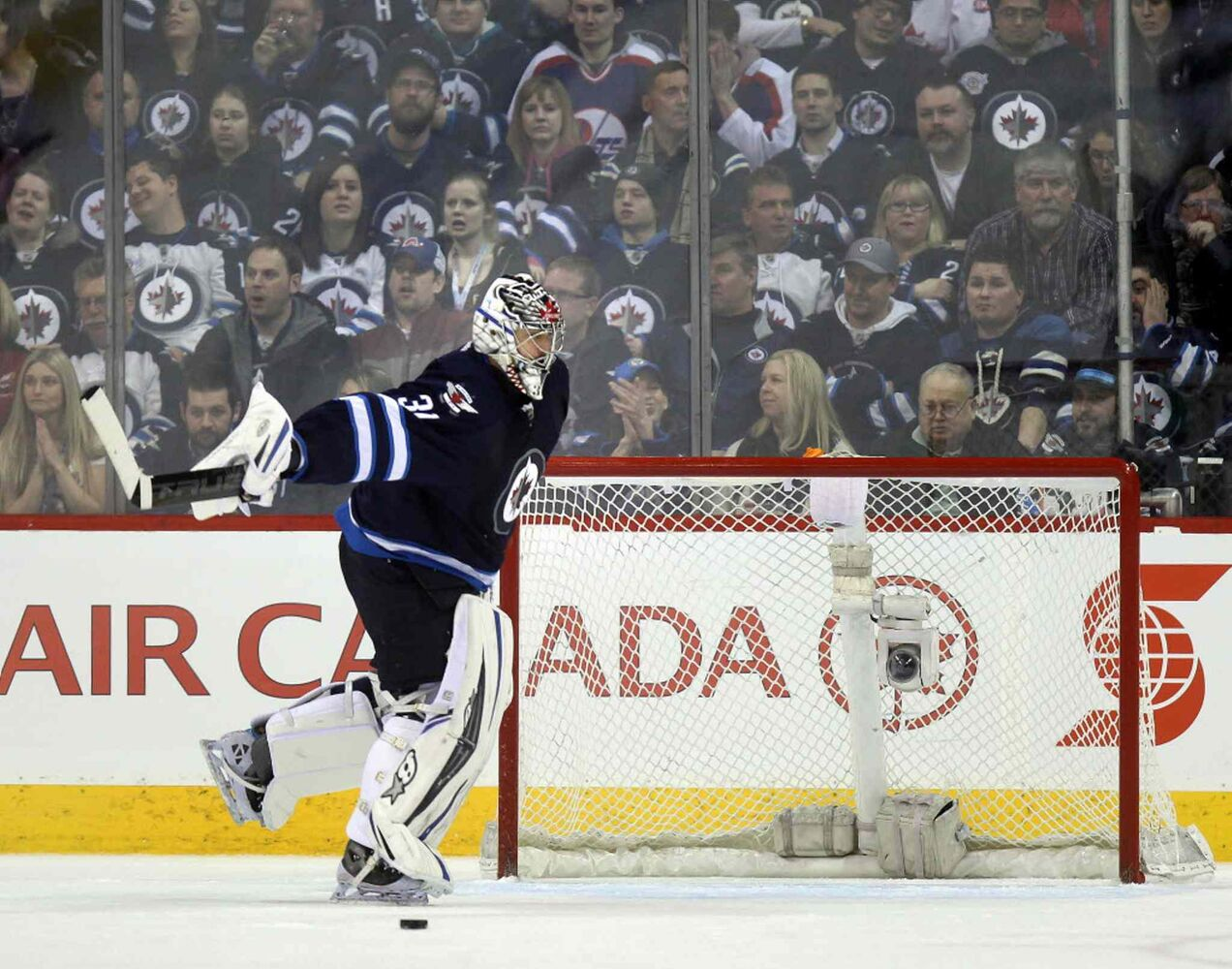 Ondrej Pavelec sweeps a goal by Los Angeles Mike Richards out of his net during the second period.  (Phil Hossack / Winnipeg Free Press)