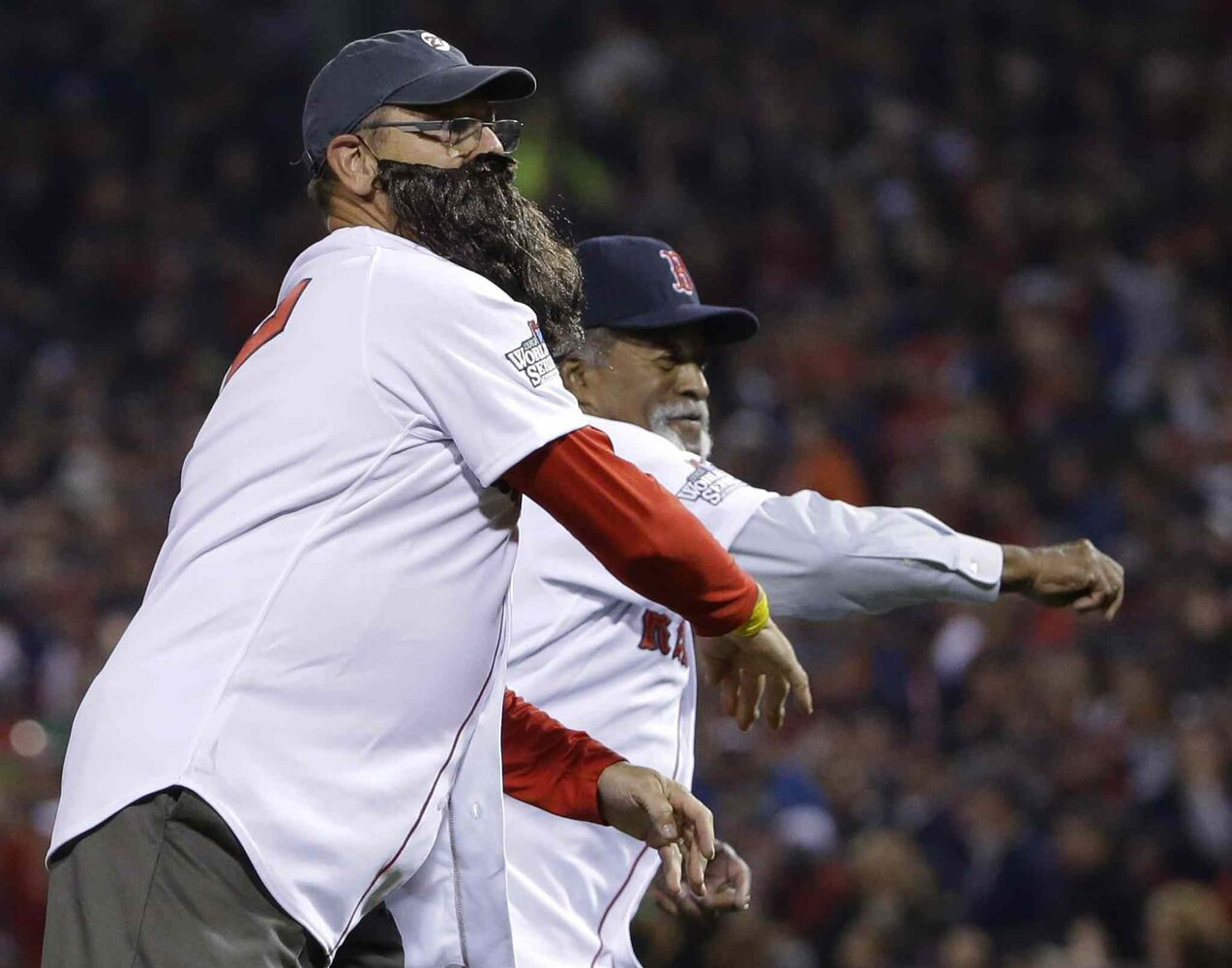 Former Boston Red Sox Hall of Famer Carlton Fisk (right) sports a fake beard as he and three-time All-Star Luis Tiant throw out the ceremonial first pitches before Game 6.