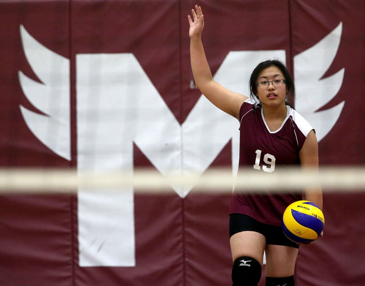 DMCI Maroons' Jacquelynn Joseph prepares to serve. (TREVOR HAGAN / WINNIPEG FREE PRESS)