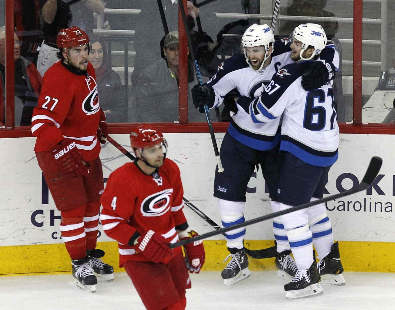 Winnipeg Jets' Andrew Ladd (16) celebrates his second-period goal with teammate Michael Frolik (67) during Tuesday's game in Raleigh.
