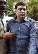 Rakesh Kumar, the head of the India's film censorship board, is produced before a court in Mumbai, India, Tuesday, Aug. 19, 2014. Police say they have arrested Kumar for allegedly taking bribes in exchange for speeding up the approval of a film. (AP Photo/ Press Trust of India) INDIA OUT