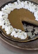 This Oct. 20, 2014, photo shows ultra creamy pumpkin pie in Concord, N.H. The pie has a chocolate crumb pie crust, but the filling will work wonderfully in any crust. (AP Photo/Matthew Mead)