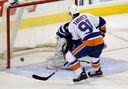 Isles beat Jets 5-4 in shootout
