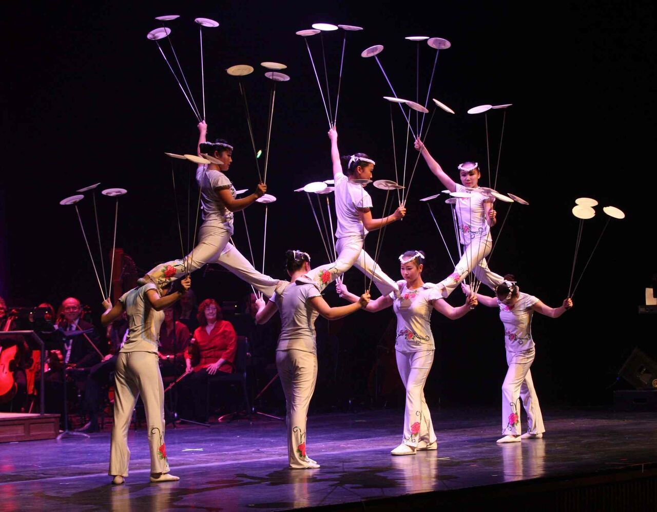 The Peking Acrobats perform 'Let the Spinning Plates Spin', precariously balancing dishes in time with the music.