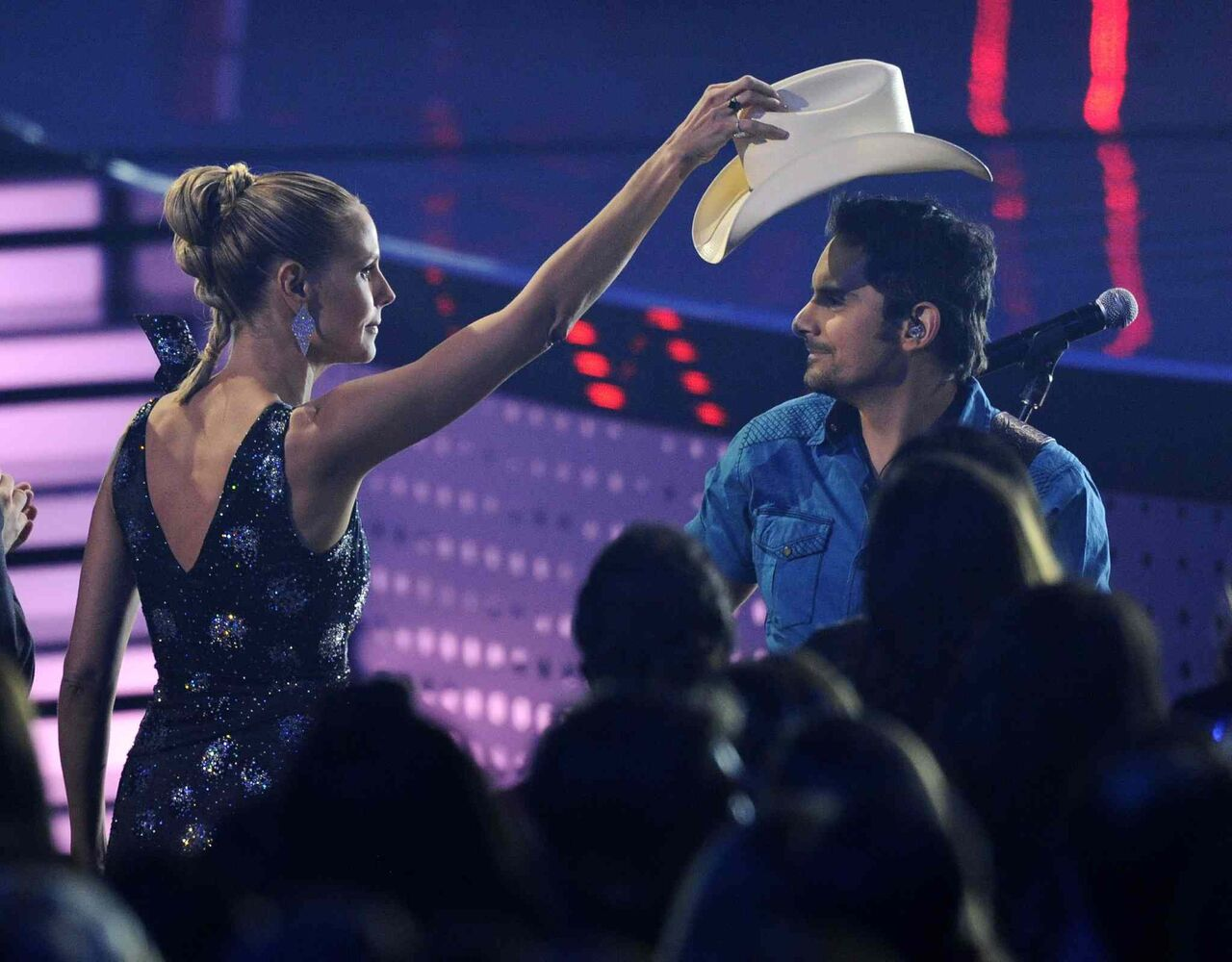 Heidi Klum takes Brad Paisley's hat as he performs 'The Mona Lisa' on stage at the 40th annual People's Choice Awards at the Nokia Theatre L.A. Live on Wednesday. (Chris Pizzello/ Invision/ The Associated Press)