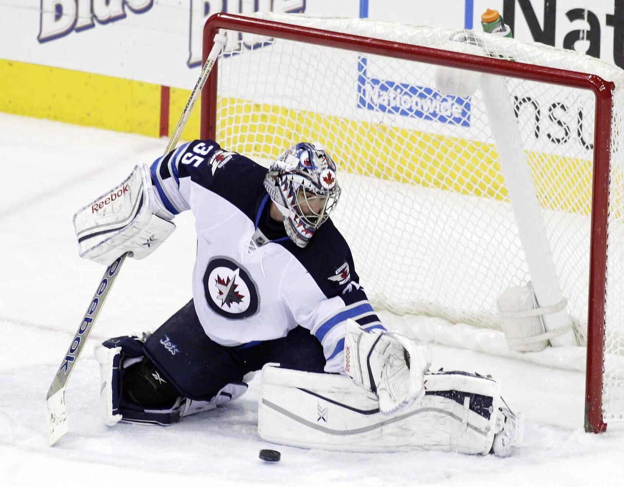 Al Montoya makes a save Monday night. (Jay LaPrete / The Associated Press)