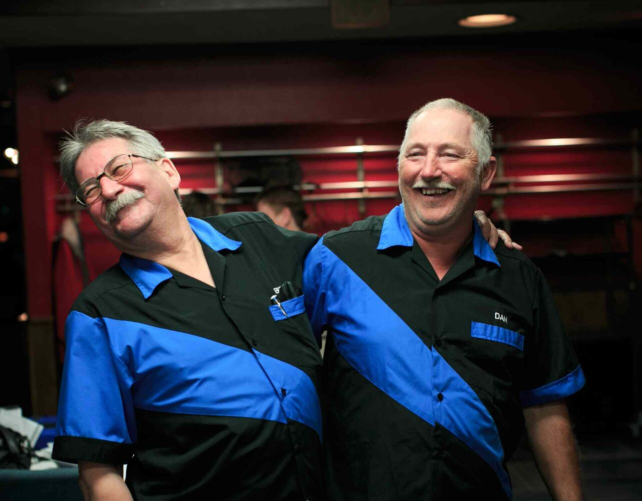 Darts teammates Bud Hawkins and Dan Cady laugh during a game at the St. James Legion off Portage Ave. (Melissa Tait / Winnipeg Free Press)