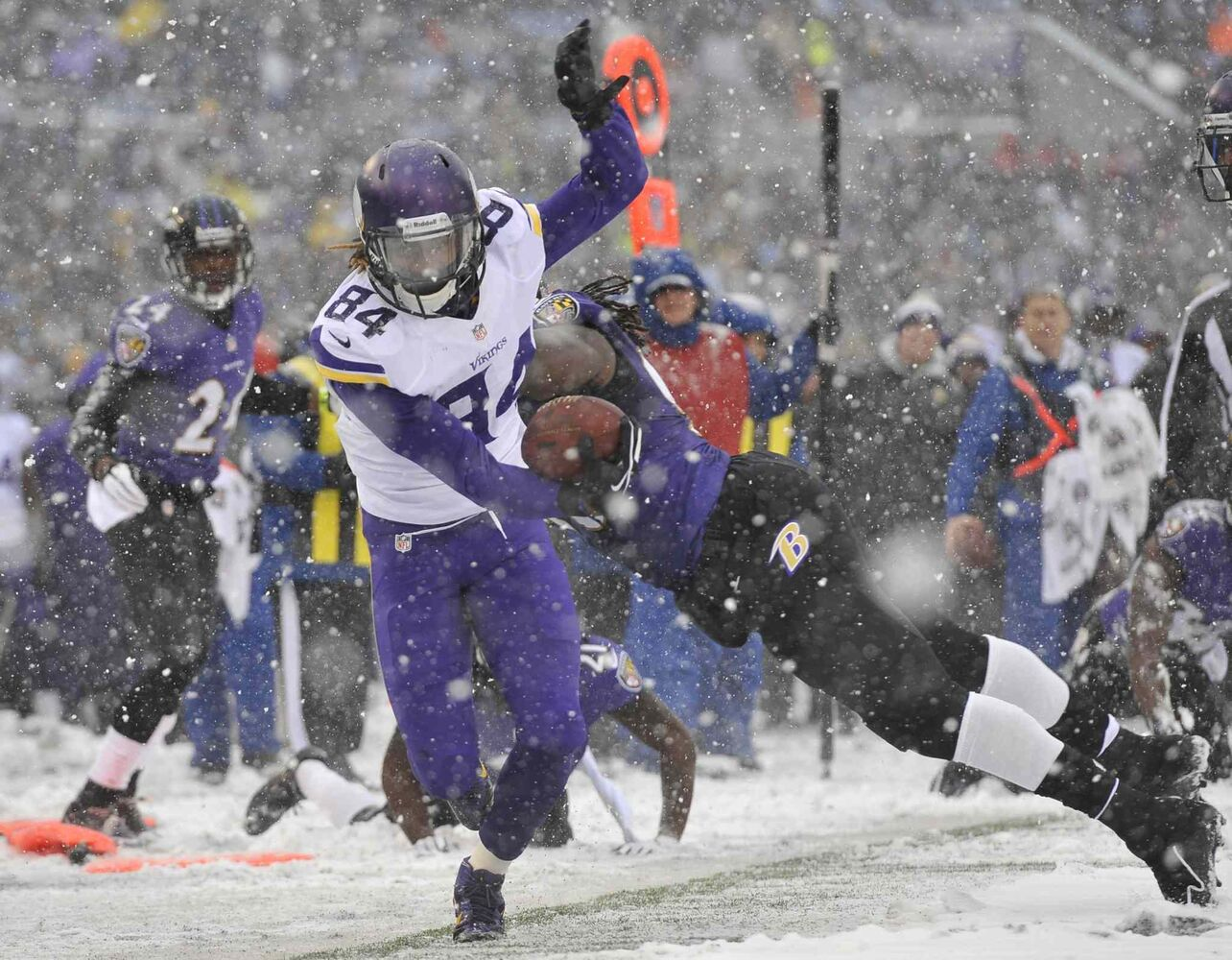 Minnesota Vikings wide receiver Cordarrelle Patterson (84) tries to stay in bounds as he rushes the ball past Baltimore Ravens linebacker Pernell McPhee. (Gail Burton / The Associated Press)