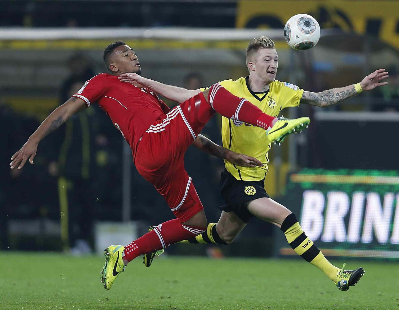 Bayern's Jerome Boateng (left) and Dortmund's Marco Reus chase the ball during the German Bundesliga action between BvB Borussia Dortmund and Bayern Munich in Dortmund, Germany on Saturday.
