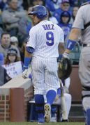 Chicago Cubs' Javier Baez reacts after being called out on strikes during the ninth inning of a baseball game against the Los Angeles Dodgers in Chicago, Sunday, Sept. 21, 2014. The Dodgers won 8-5. (AP Photo/Nam Y. Huh)