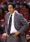Miami Heat head Coach Erik Spoelstra looks on during first half action of an NBA basketball game against the Utah Jazz in Miami, Wednesday, Dec 17, 2014. (AP Photo/Joel Auerbach)