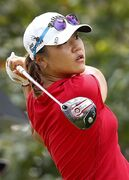 FILE - In this March 8, 2015, file photo, Lydia Ko of New Zealand tees off on the ninth hole during the final round of the HSBC Women's Champions golf tournament in Singapore. Seventeen months after she turned pro, Ko has done just about everything but win a major. (AP Photo/Wong Maye-E, File)
