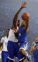 CORRECTS TO FRIDAY NOT THURSDAY - Kentucky's Aaron Harrison, front right, shoots under pressure from Alex Poythress during the team's NCAA college basketball Big Blue Madness, Friday, Oct. 17, 2014, in Lexington, Ky. (AP Photo/James Crisp)
