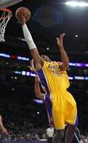 Los Angeles Lakers guard Kobe Bryant shoots during the first half of an NBA basketball game against the Oklahoma City Thunder, Friday, Dec. 19, 2014, in Los Angeles. (AP Photo/Mark J. Terrill)