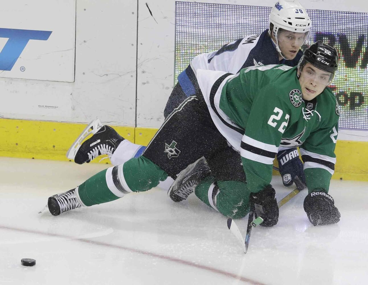 Dallas Stars centre Colton Sceviour and Winnipeg Jets defenceman Tobias Enstrom collide during the first period. (L.M. OTERO / THE ASSOCIATED PRESS)