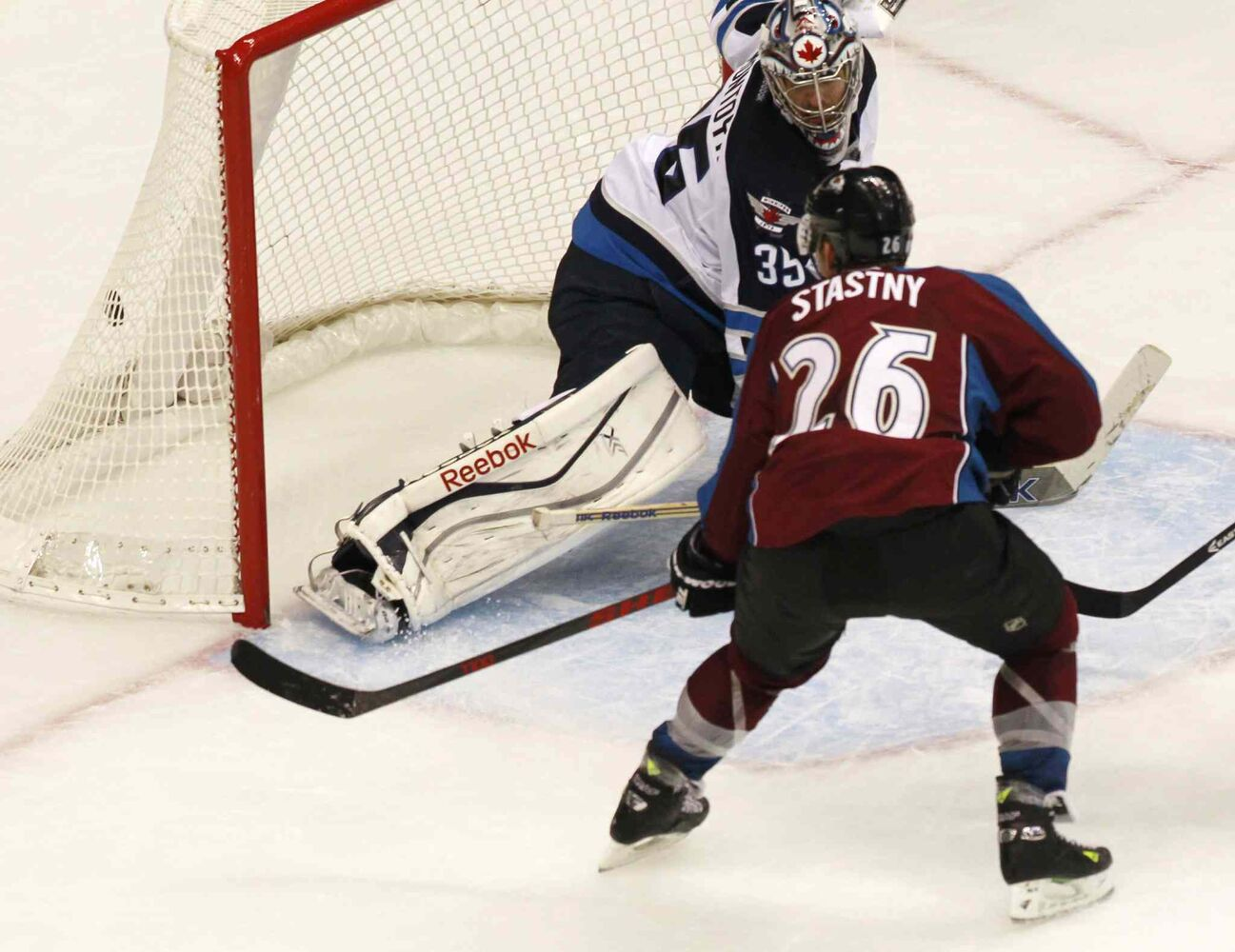 Colorado Avalanche center Paul Stastny puts the puck in the net for the go-ahead goal in the third period.