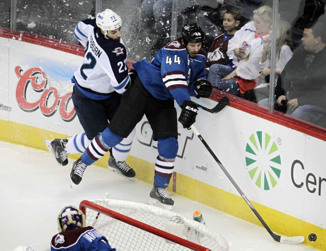 Winnipeg Jets winger Chris Thorburn (left) checks Colorado Avalanche defenceman Ryan Wilson during the first period. (Joe Mahoney / The Associated Press)