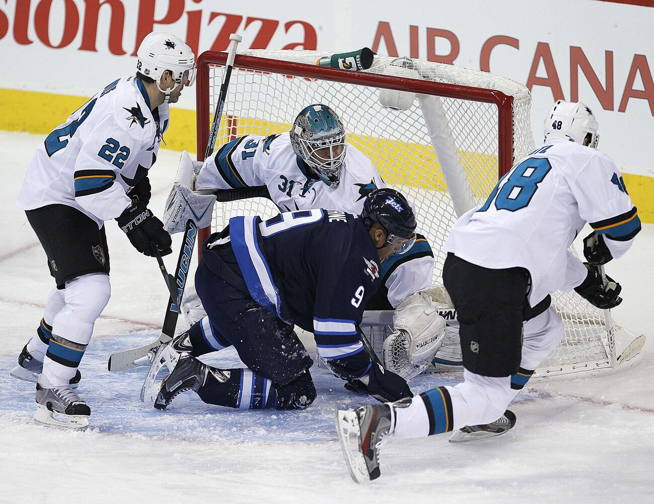 Winnipeg Jets' Evander Kane (9) plows into San Jose Sharks' goaltender Antti Niemi (31) during the first period. (JOHN WOODS / WINNIPEG FREE PRESS)