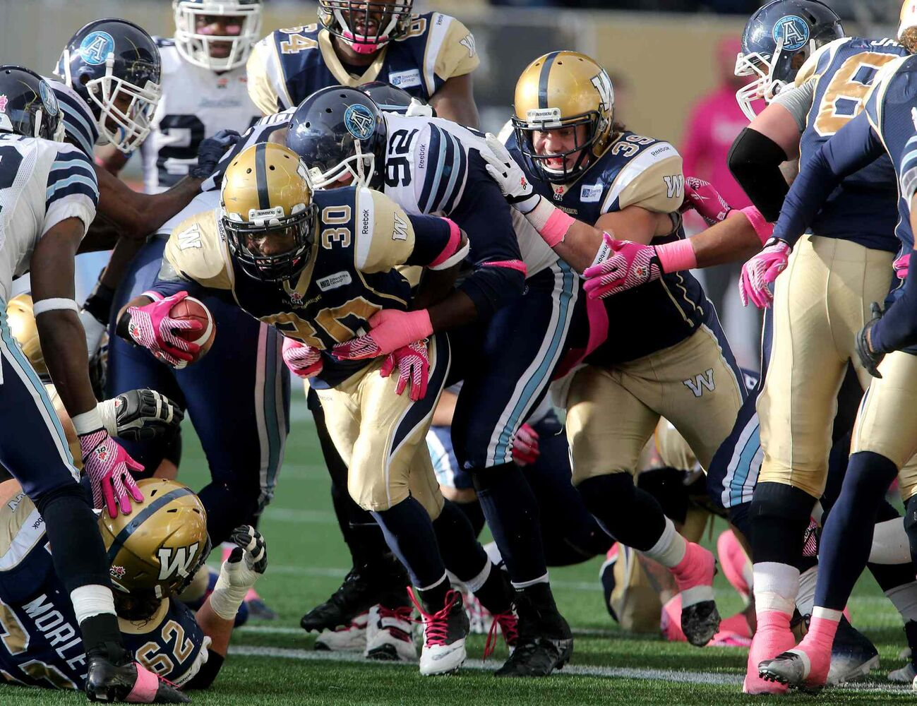 Winnipeg Blue Bombers' Will Ford (30) manages to break through the Toronto Argonauts' defensive line to score during the second half. (TREVOR HAGAN / WINNIPEG FREE PRESS)