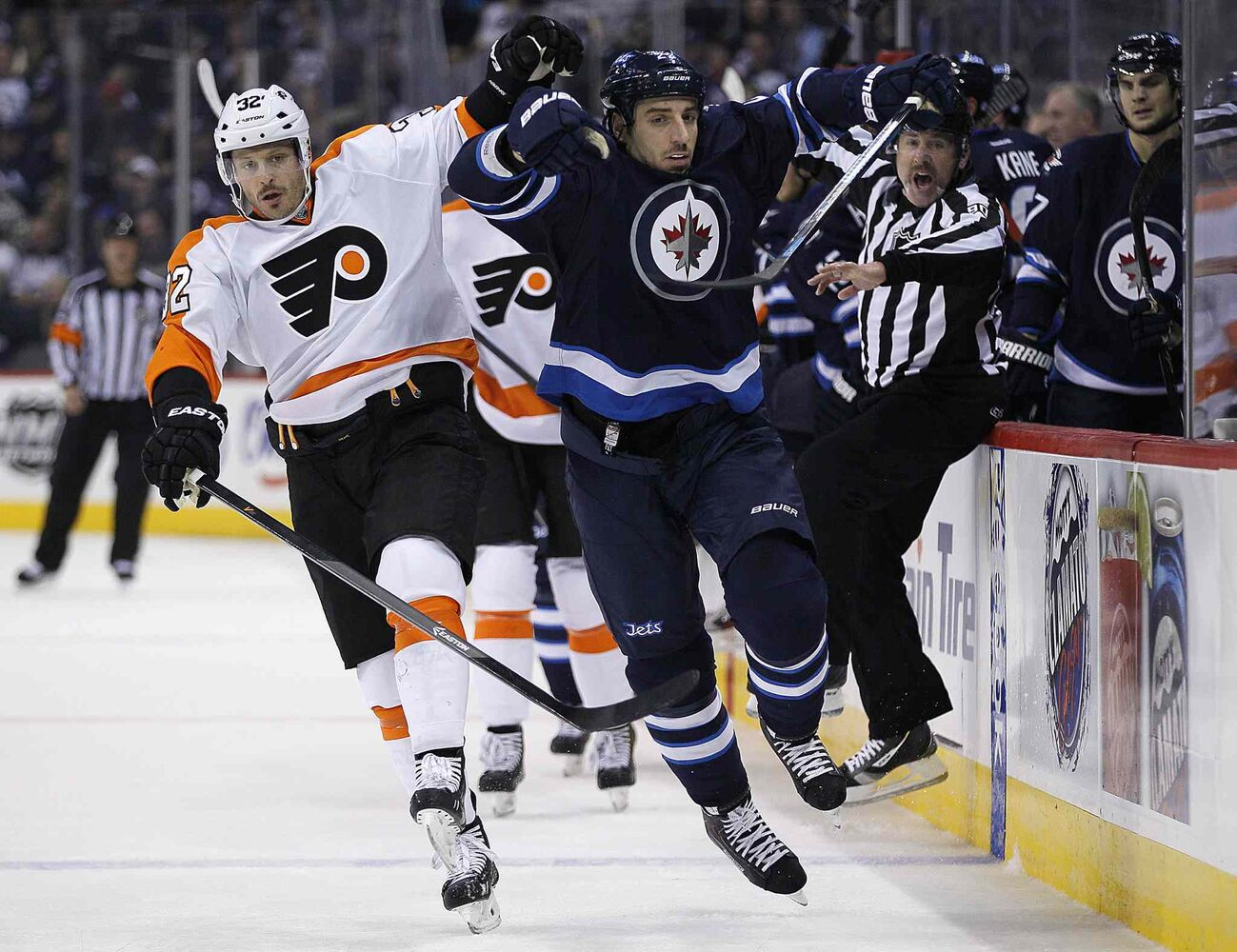 Philadelphia Flyers' Mark Streit (left) and Winnipeg Jets forward Chris Thorburn race for the puck during the second period. (JOHN WOODS / THE CANADIAN PRESS)
